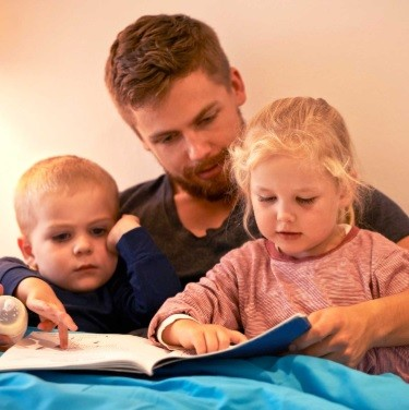 DAD READING TO CHILDREN